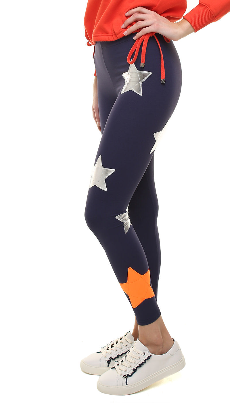 Leggings in lycra blu con stelle applicate argento e arancione fluo