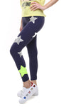 Leggings in lycra blu con stelle applicate argento e giallo fluo