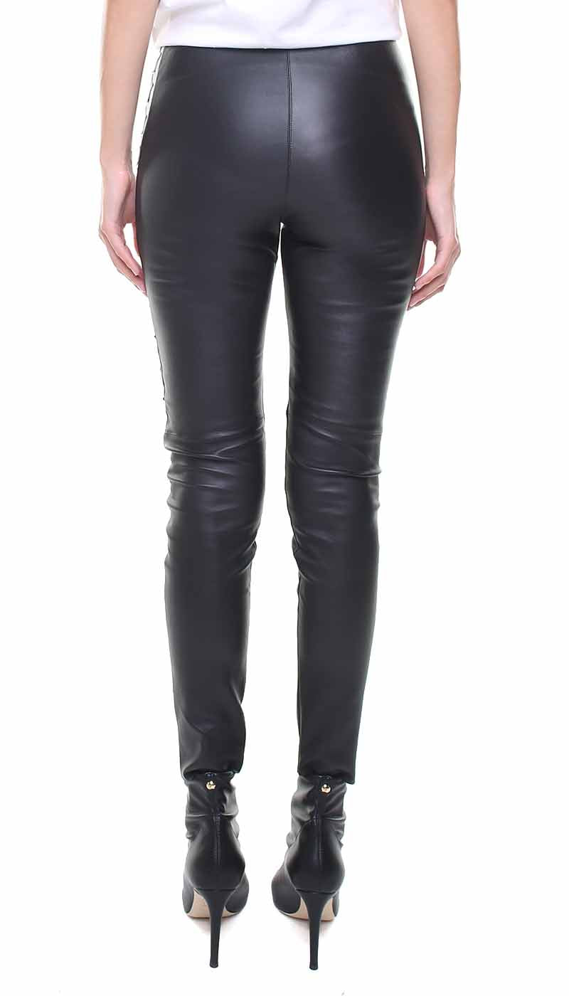Leggings in vera pelle neri con stelle applicate in pelle nera e oro