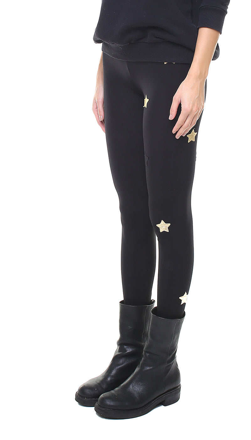 Leggings in lycra neri con stelle applicate nere e oro