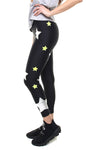 Leggings in lycra neri con stelle applicate argento e giallo fluo
