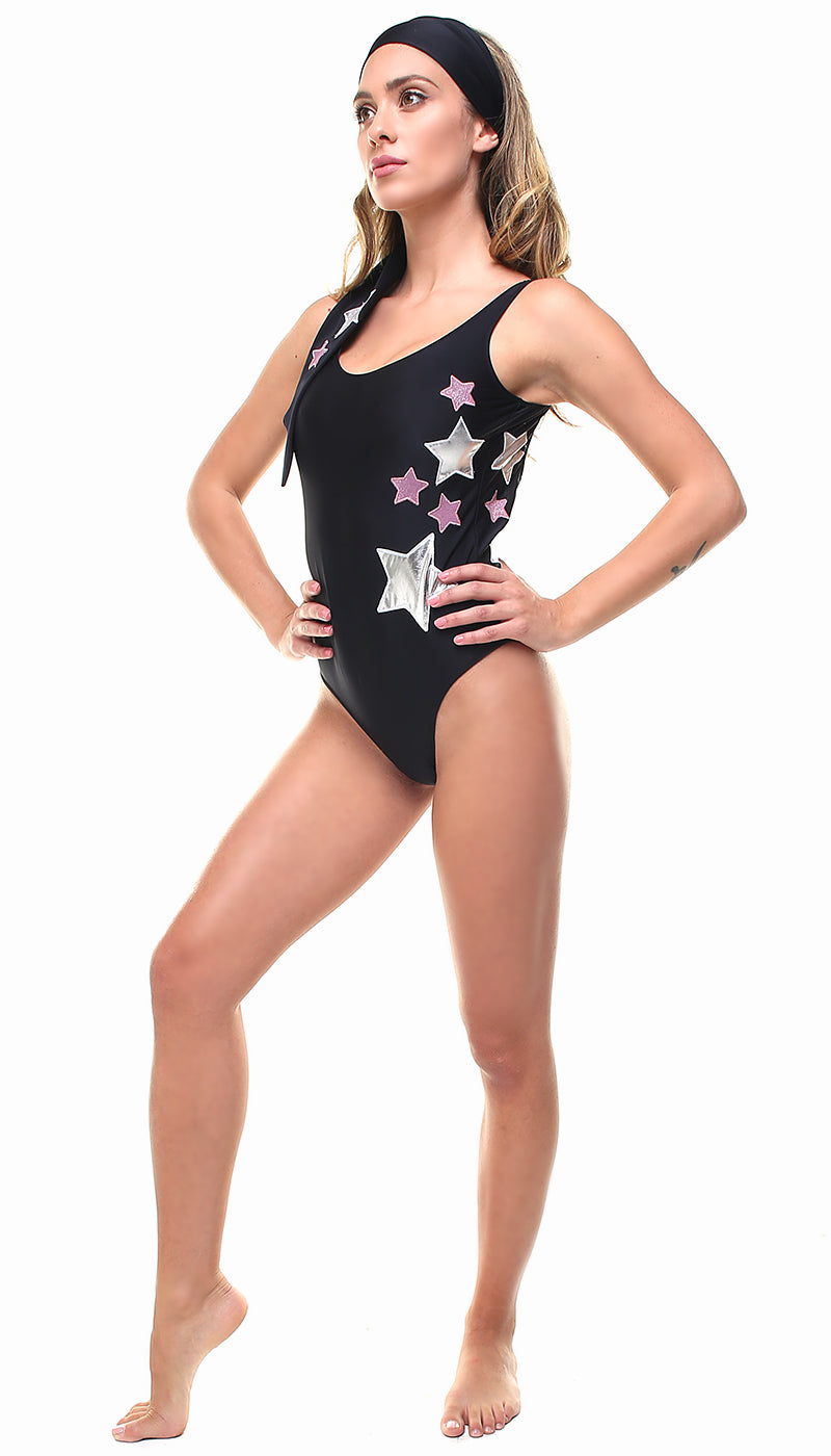 Costume olimpionico in lycra nero con stelle applicate argento e in lurex rosa scuro