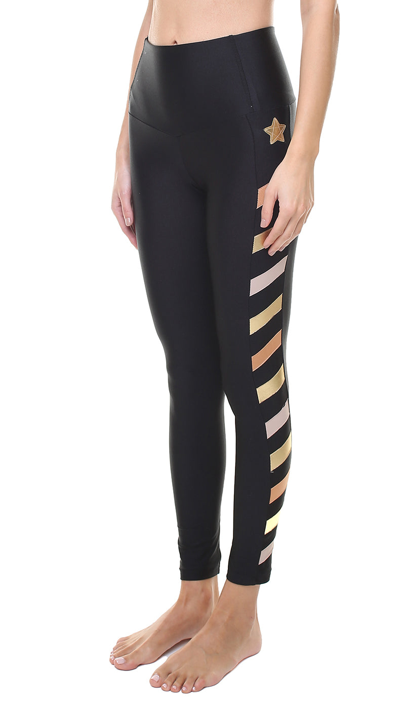 Leggings in nylon neri con stella applicata oro e bande in lycra oro cipria e rosa