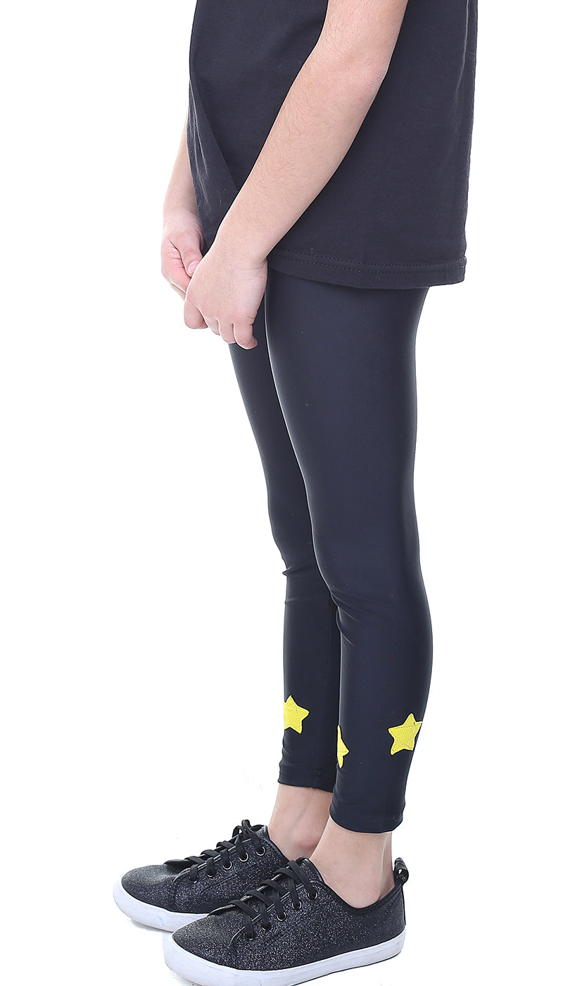 Leggings Bambina in lycra neri con stelle applicate gialle