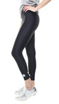 Leggings in lycra neri con stelle applicate argento