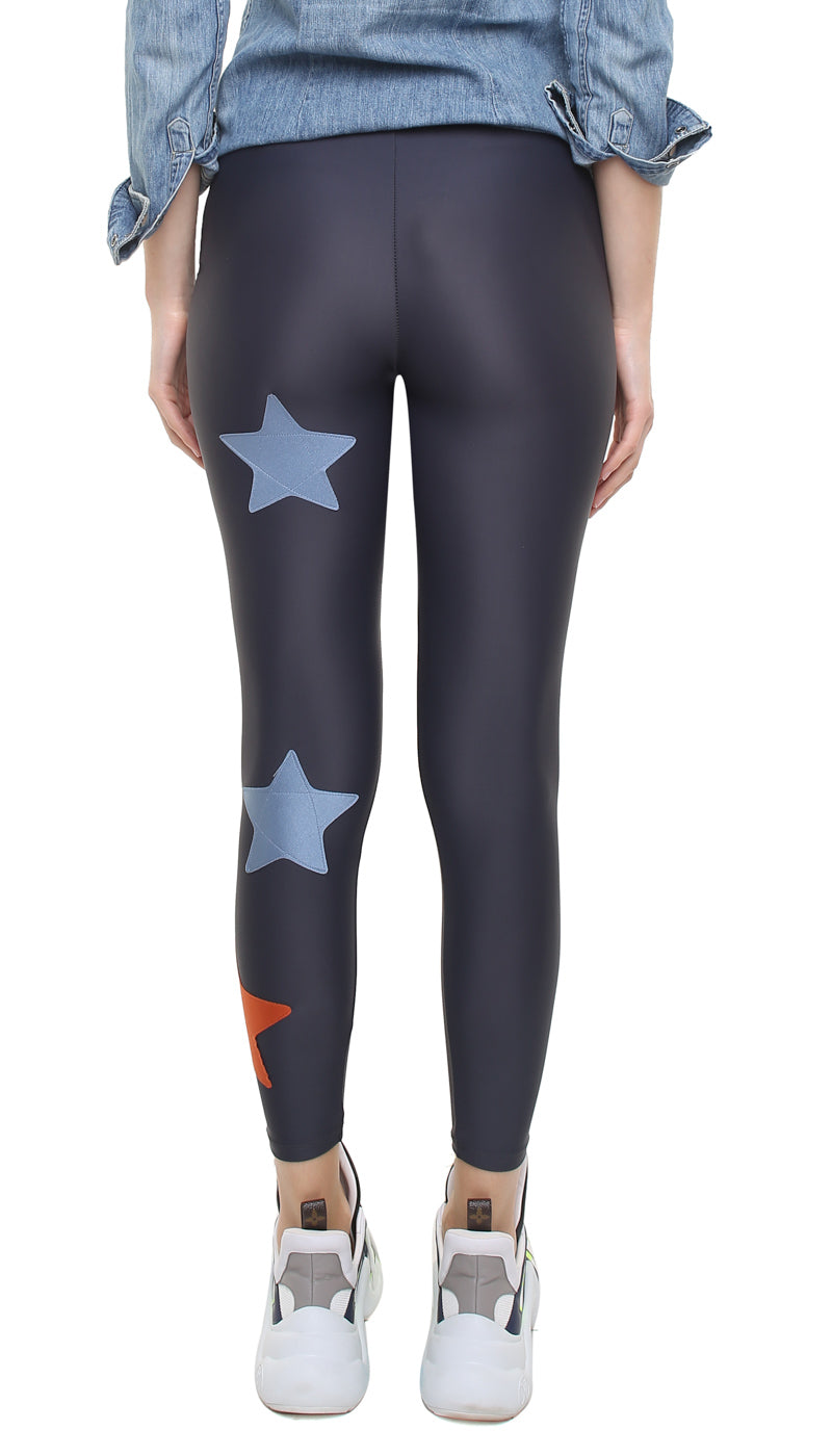 Leggings in lycra grigia con stelle applicate celeste polvere e ruggine