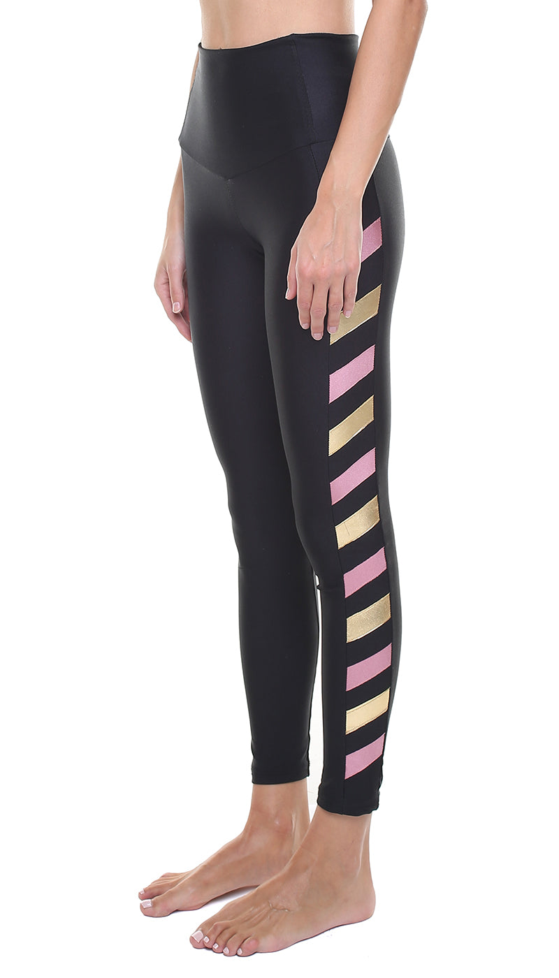 Leggings in nylon neri con stella applicata oro e bande in lycra rosa e oro
