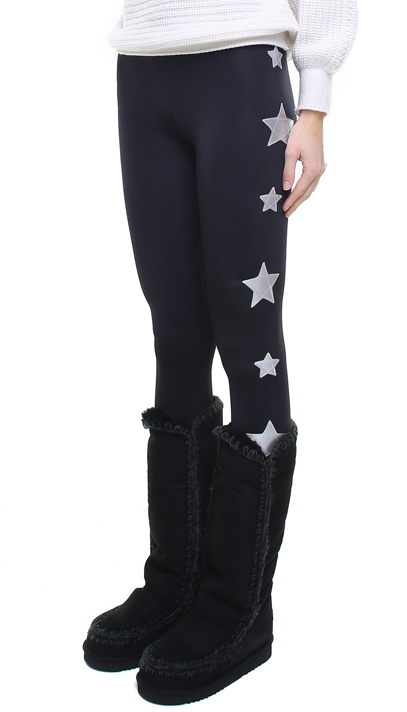Leggings in lycra felpata neri con stelle applicate in ecopelle argento