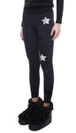 Leggings in lycra felpata neri con stelle applicate in ecopelle argento e in velluto nero
