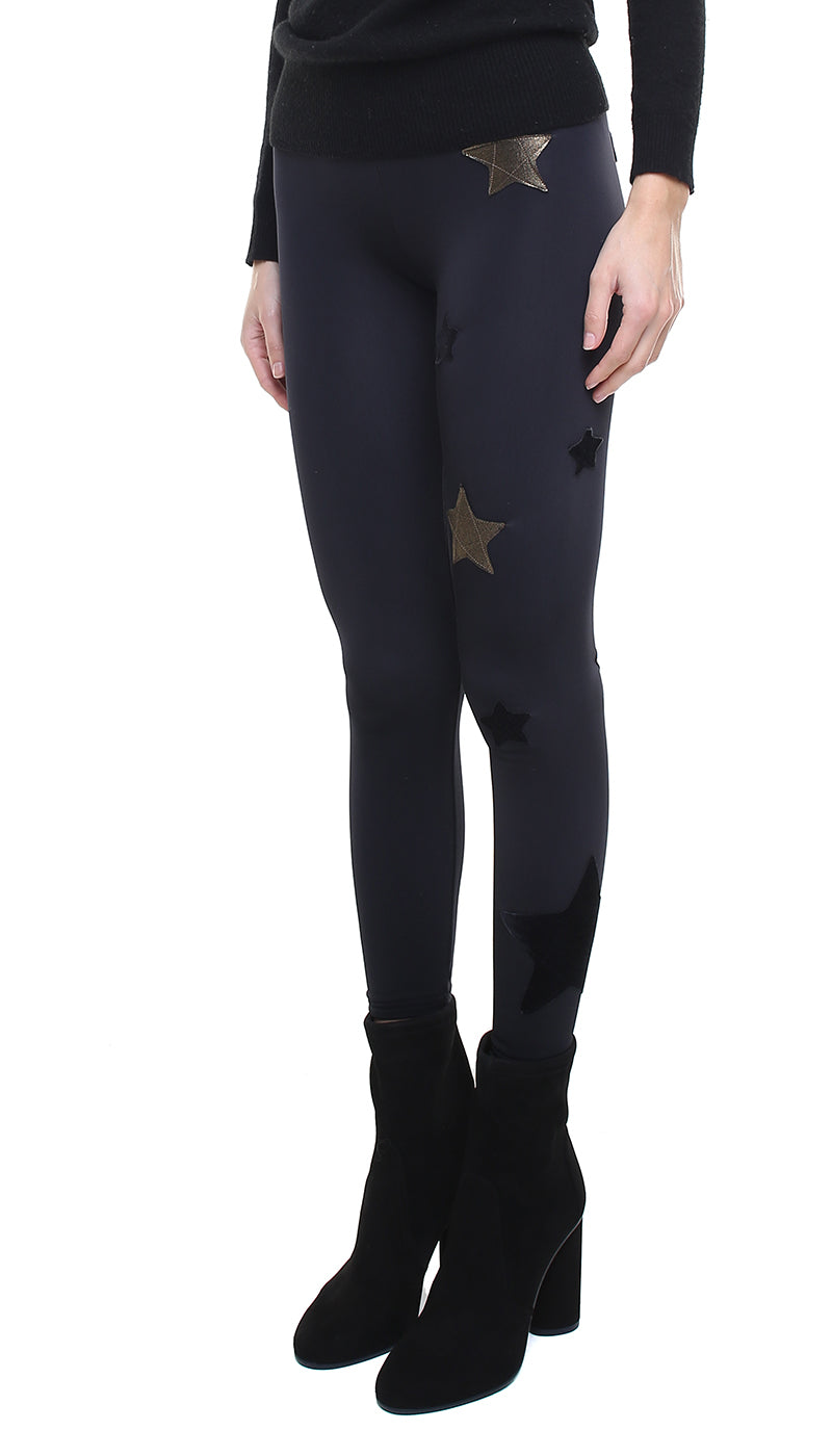 Leggings in lycra felpata neri con stelle applicate oro e in velluto nero