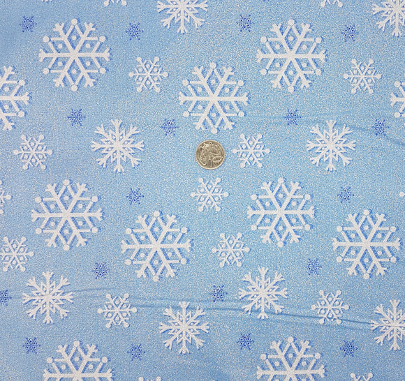 Glitter snowflake on blue
