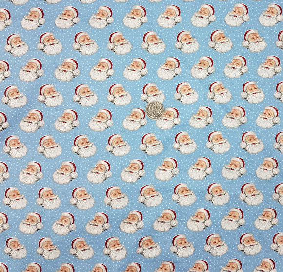 Christmas Santa face on dotted blue background