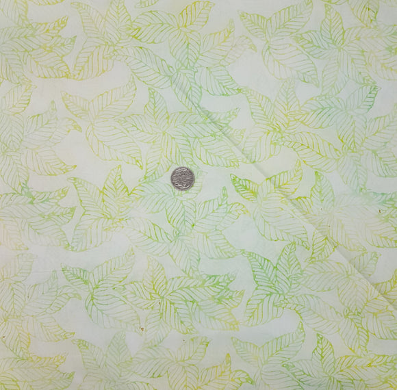 Batik, yellow and green leaf print on pale green