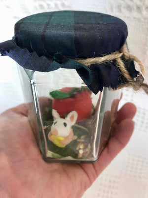 "Faery creature. ""Large mouse in a jar, holding yellow button "".Decorative only. Does not require food or water. (116LM2)"