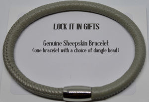 Bracelet. Genuine single sheepskin bracelet, with a dangle bead. Lock It In Gifts.  (721)