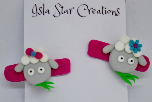 Hair clips. Pink with sheep. By Isla Star Creations.  (132HC4)