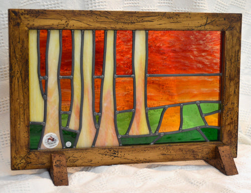 Stained Glass panel by Wild Hare Glass. Sunset scene. Wooden frame. (17WHGSUN)
