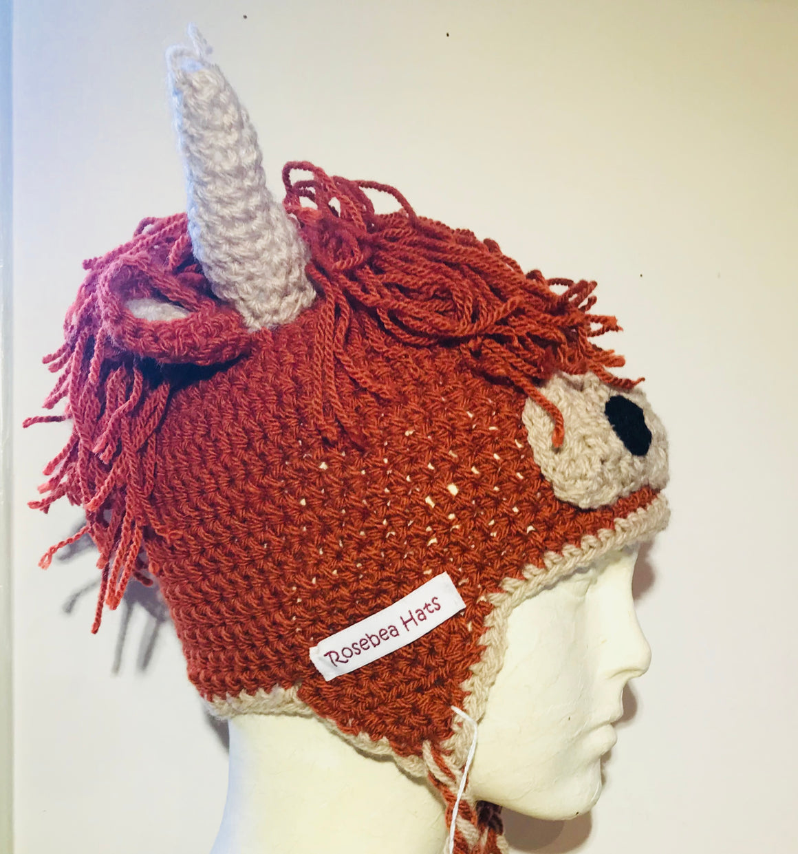 Highland Cow. Wool / acrylic knitted hat in red or black by Rosebea Hats.