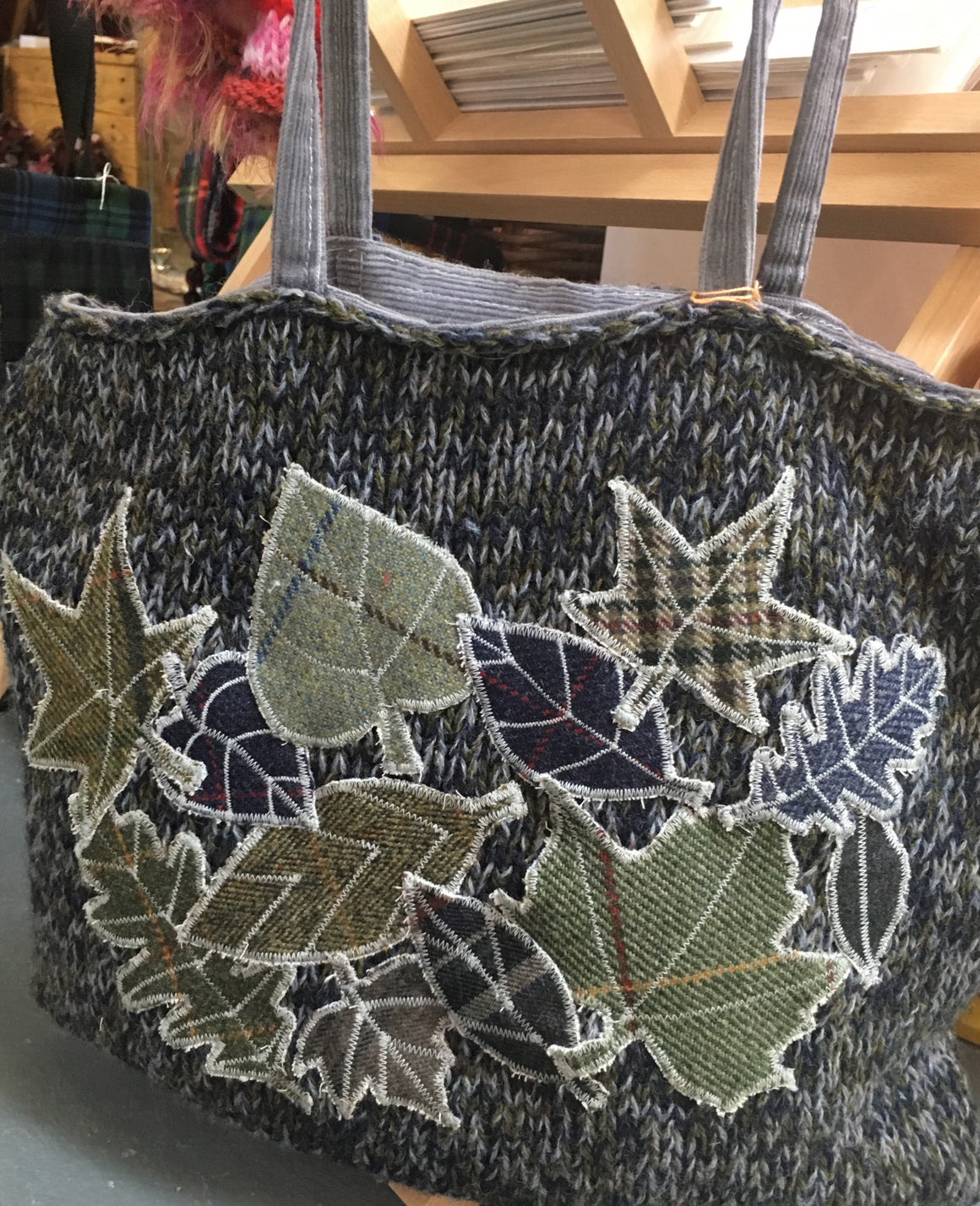 Grey knitted shoulder bag with leaf appliqué detail