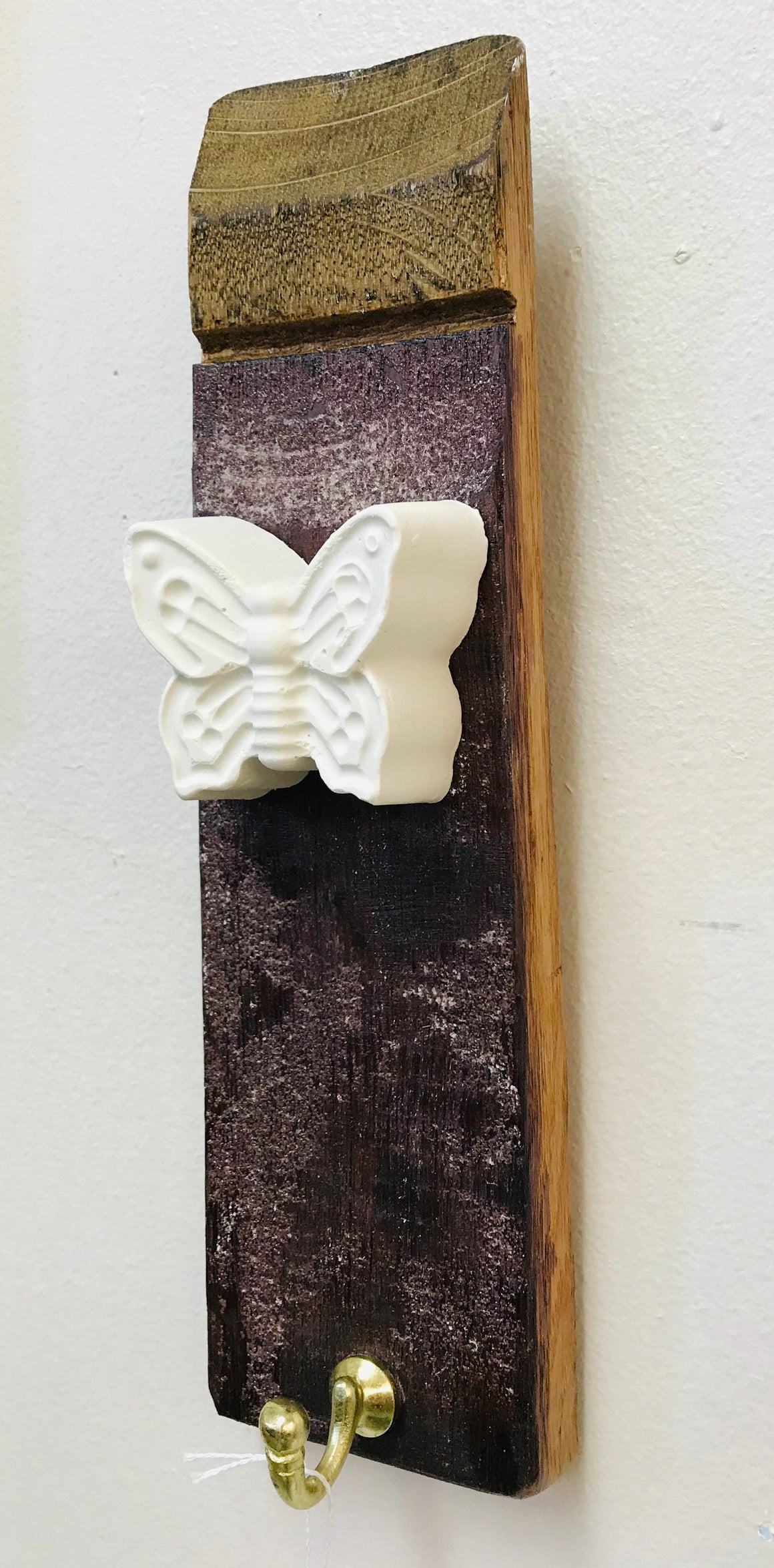 Stave hook with plaster cast insect motif. Butterfly.
