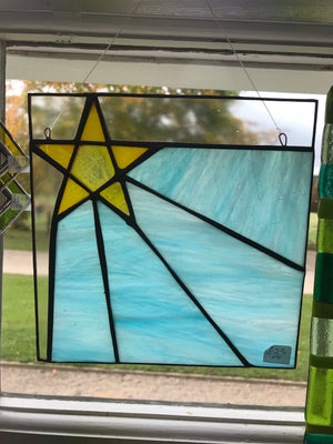 Shooting star. Stained glass. Window or wall hanging.