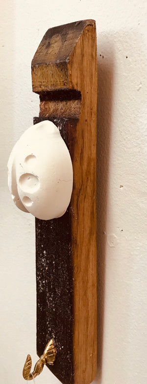 Stave hook with plaster cast insect motif. Lady bird.
