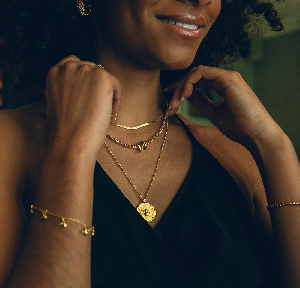 Gold Bee Coin Necklace layered with our bee fastener and snake chain necklaces