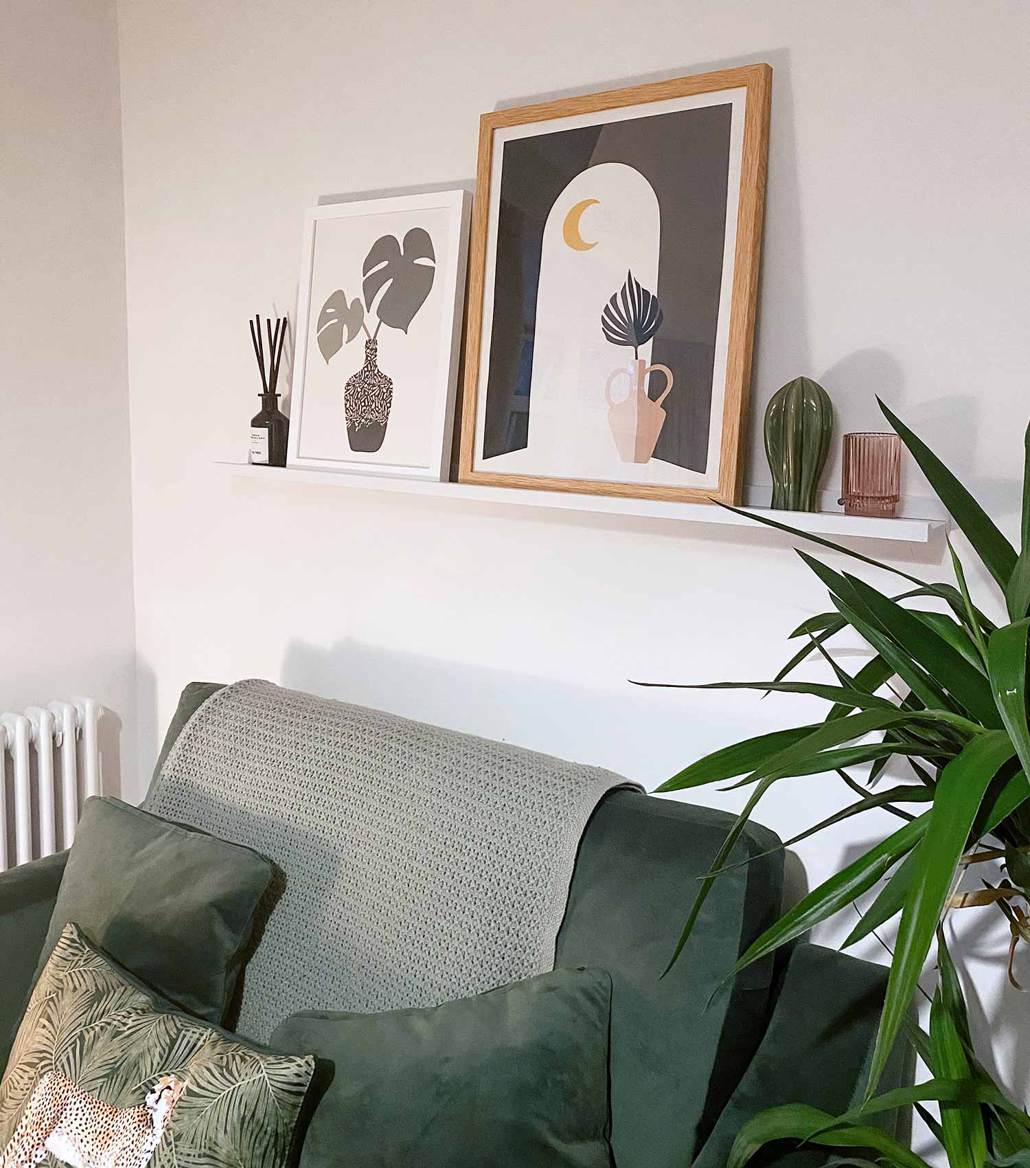 Green Lili Framed Botanical Prints on Picture Shelf above Sofa