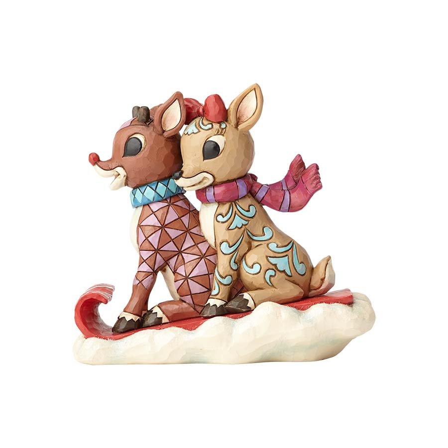 Rudolph and Clarice Sledding
