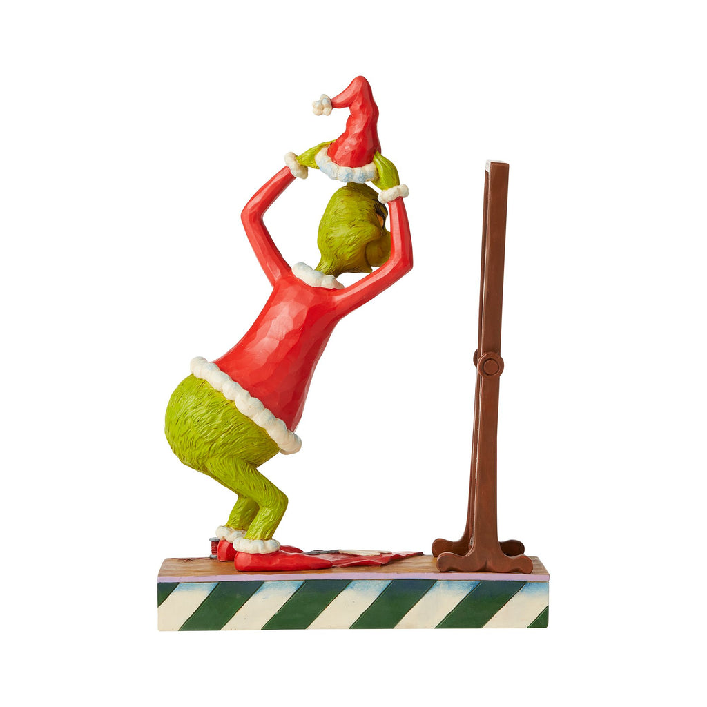Grinch Dressing in Santa Suit