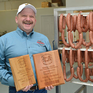 Local sausage maker grinds out two awards