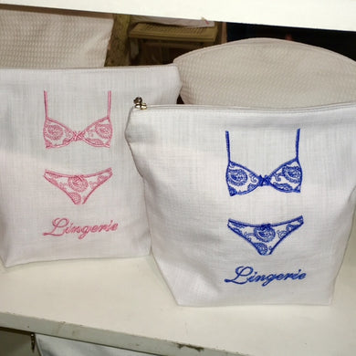 Made in South Africa, our feminine lingerie bag features a delightful embroidered bikini.