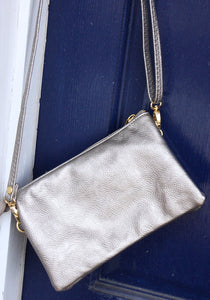 Perfect for any occasion are Caroline Hill's crossbody bag which also functions as a wristlet.  Available in beautiful soft leather or suede like fabric.