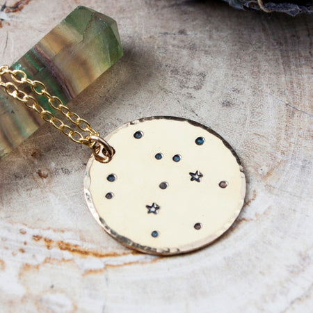 Aquarius zodiac constellation necklace with traits in sterling silver and gold