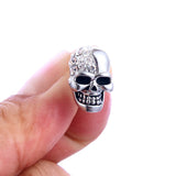 """Phantom"" Stainless Steel Skull Stud Earrings - being held"