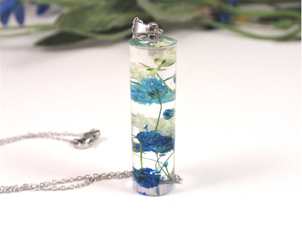 handmade crystal clear cylinder resin necklace contains real dried flowers