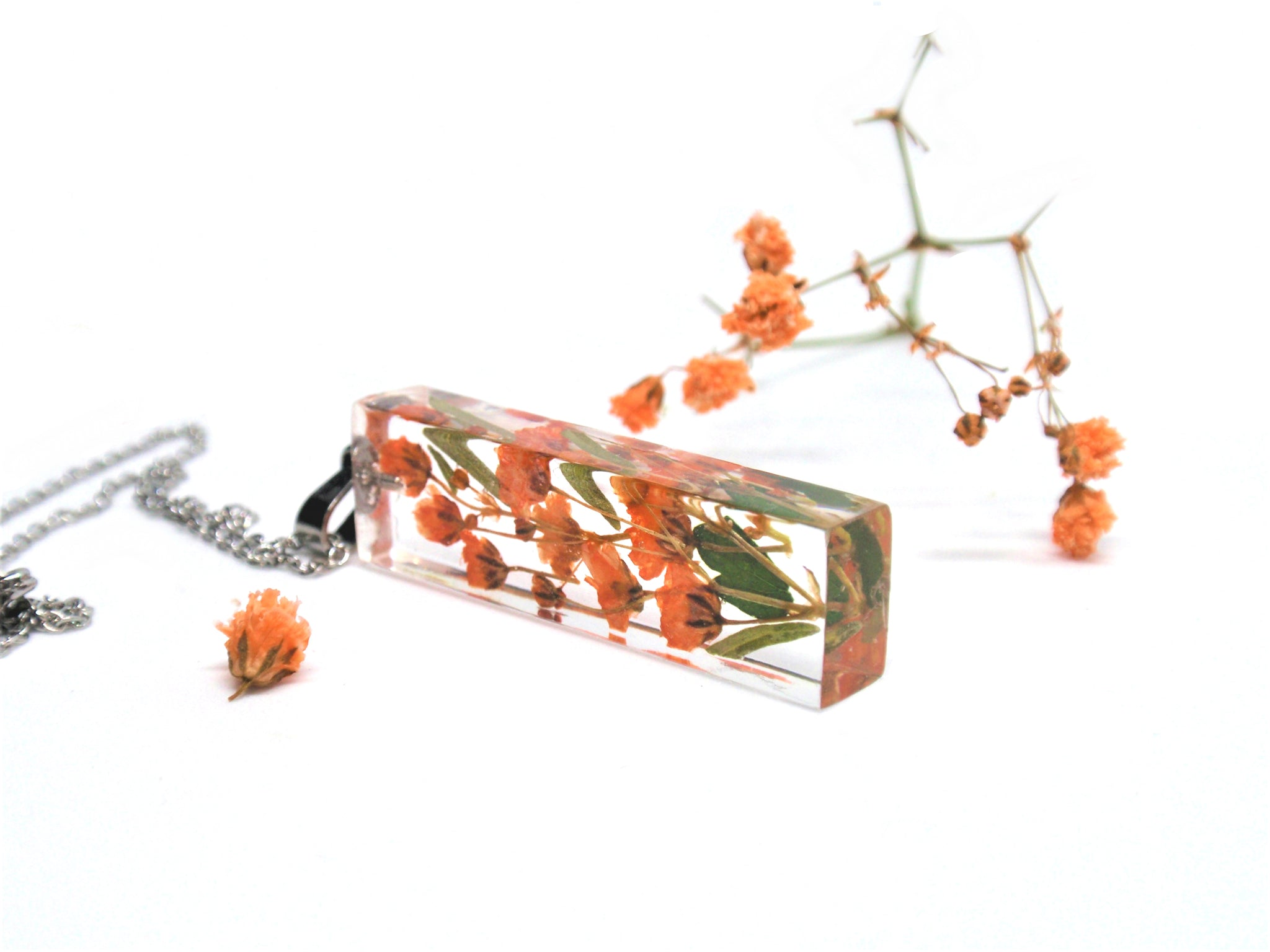Handmade Terrarium Necklace with orange babys breaht flowers