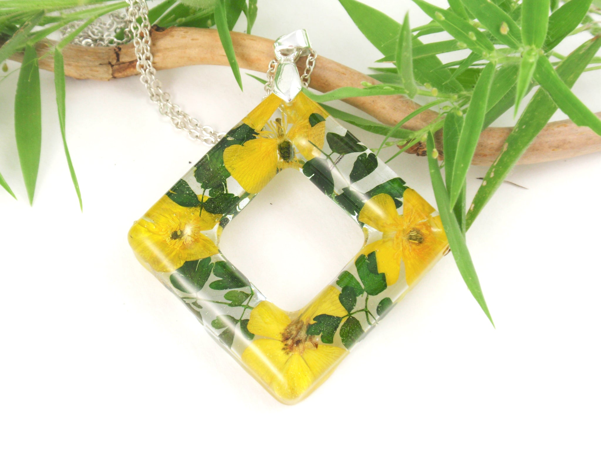 Yellow buttercup flower in resin