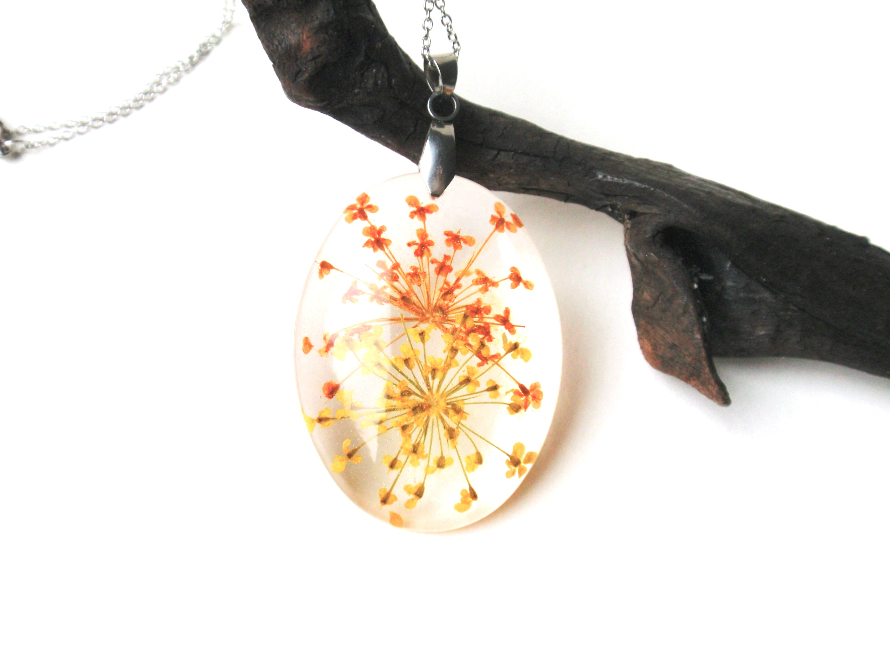 Silver pendant necklace with yellow flower in resin
