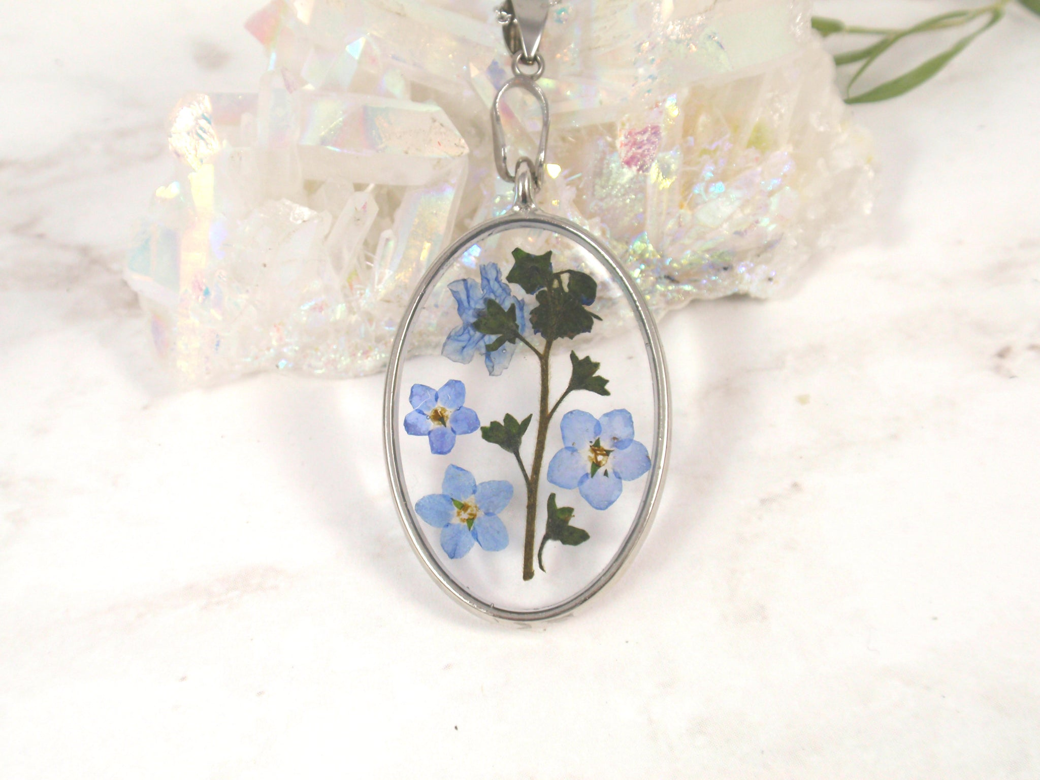 Forget Me Not flower oval necklace