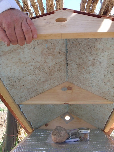 Storage area under Top Bar Hive roof