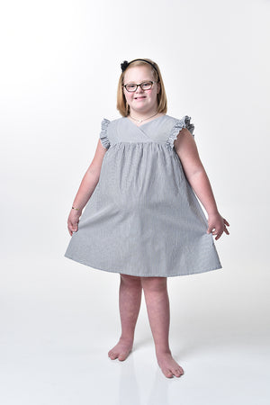 Ruthie in the black and white girls plus size Congratulations Dress