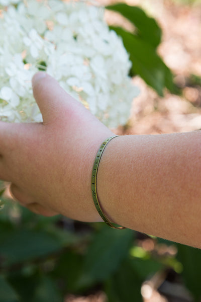 Ruthie wearing Wonderfully Made bracelet cuff