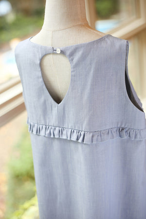 Girls plus size chambray dress with ruffled top close up