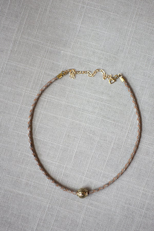 Gray leather choker with brass bead charm