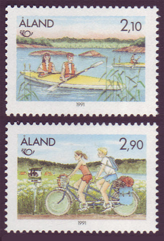 aland set of 2 stamps showing boy and girl kayaking and bicycling.