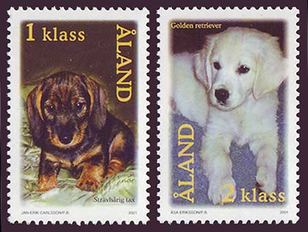 Aland set of 2 stamps showing puppies.