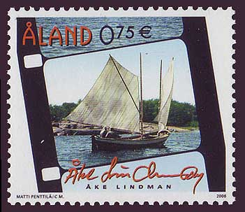 Aland stamp showing fishing boat in film frame.