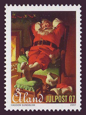 Aland stamp showing Santa relaxing by the fire.