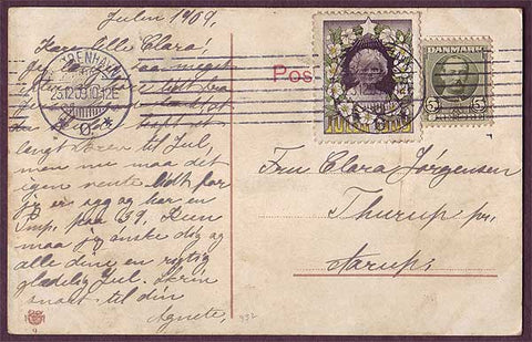 DE8006 Denmark 1909 Christmas seal tied to postcard.